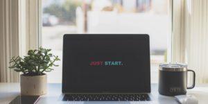 Ноутбук с текстом на экране: Just start